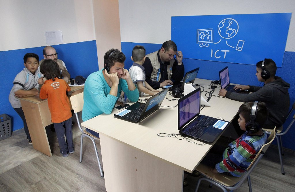 Picture shows young migrants from Afghanistan, Iraq, Pakistan and Syria taking lessons in a classroom. Photo/Archive/EPA