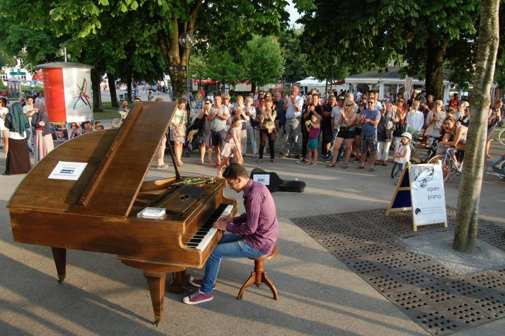 A refugee playing the public piano in Bregenz, Austria Photo credit: Open Piano for Refugees