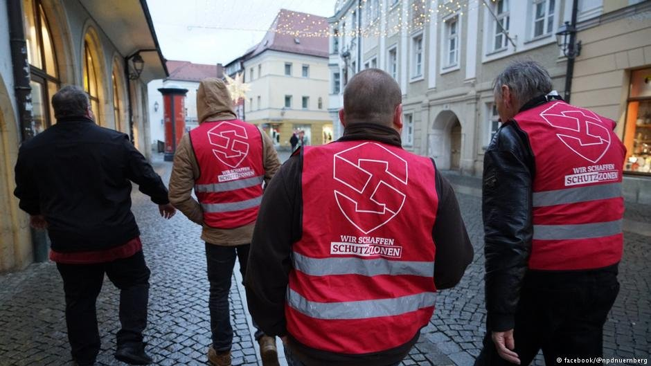 "Four NPD members stroll through the streets of Amberg to create ""safe zones"" 