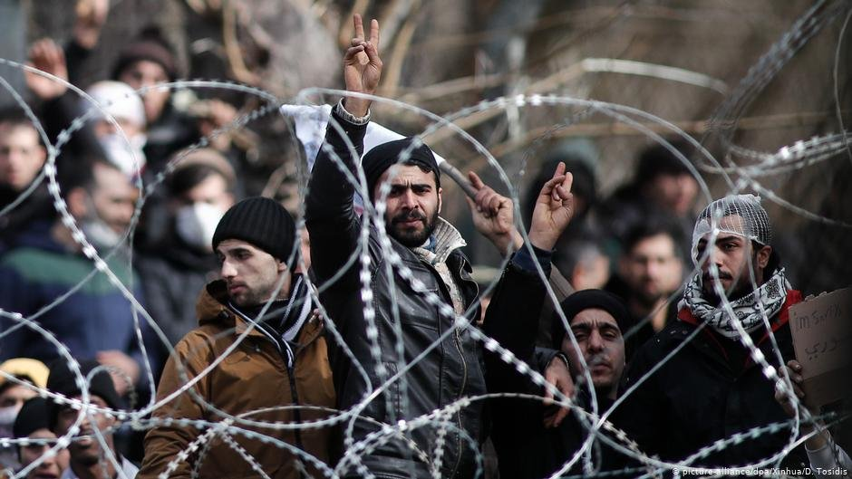 Migrants gather on the Greek-Turkish border in early March after the border crossing was closed  Photo picture-alliance