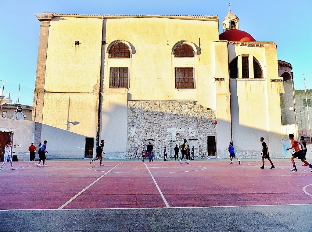 Young people playing football on the pitch at Casa Santa Chiara in Palermo  Photo Roberta Paolucci