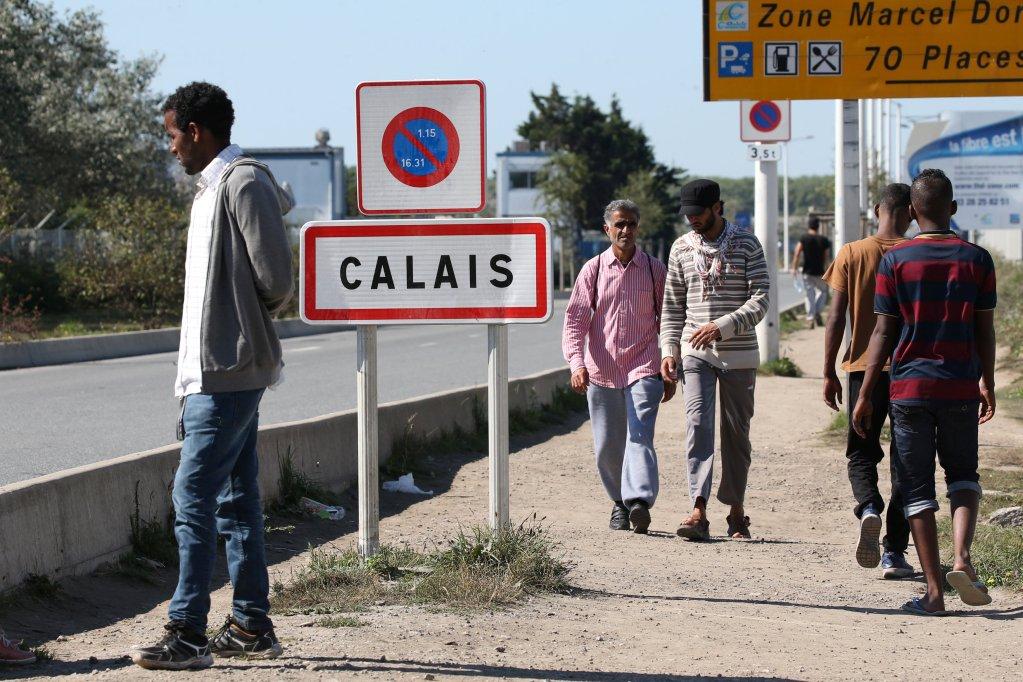 Des migrants à Calais, fin septembre 2016. Crédit : Reuters