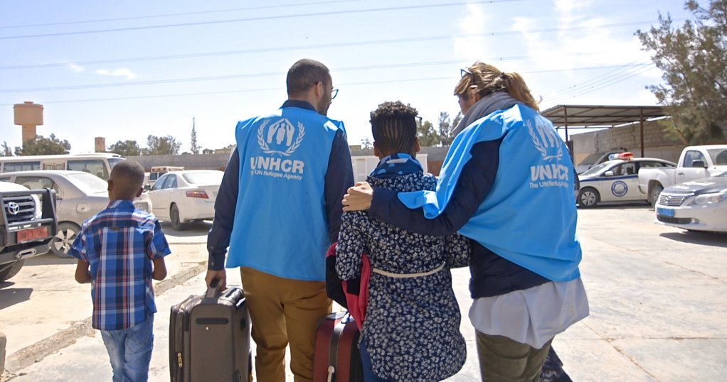 UNHCR staff members in Libya accompany two Eritrean kids out of a Libyan detention center  Photo UNHCR  Tarik Argaz