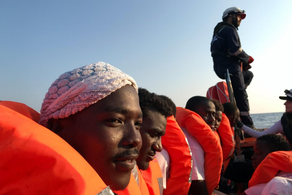 Migrants rescued by the Ocean Viking being tranferred to Maltese boats |Anne Chaon/AFP