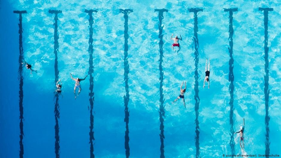 Swimmers at the outdoor public pool in Ricklinger Bad Germany  Photo picture allianceJ Stratenschulte