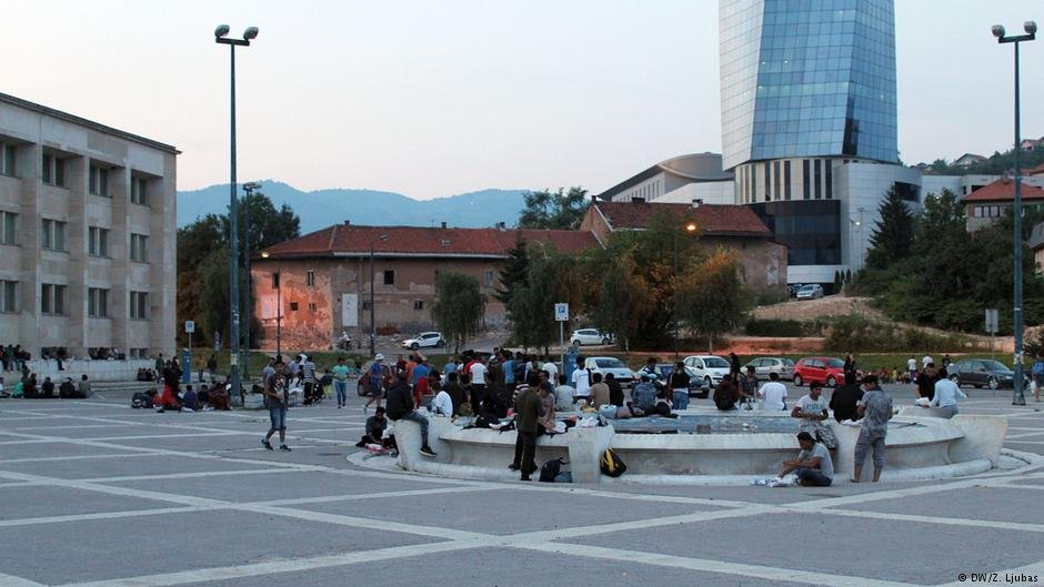 Refugees mill around on the square outside Sarajevo's railway station