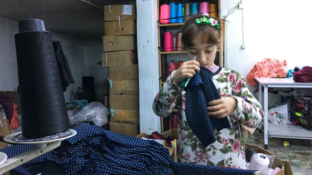Aras is 11 years old and starts her day working at this textile factory at 8 a.m. She often doesn't finish until 8 p.m. | Credit: Julia Hahn