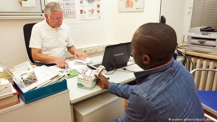 German doctor talking to African patient