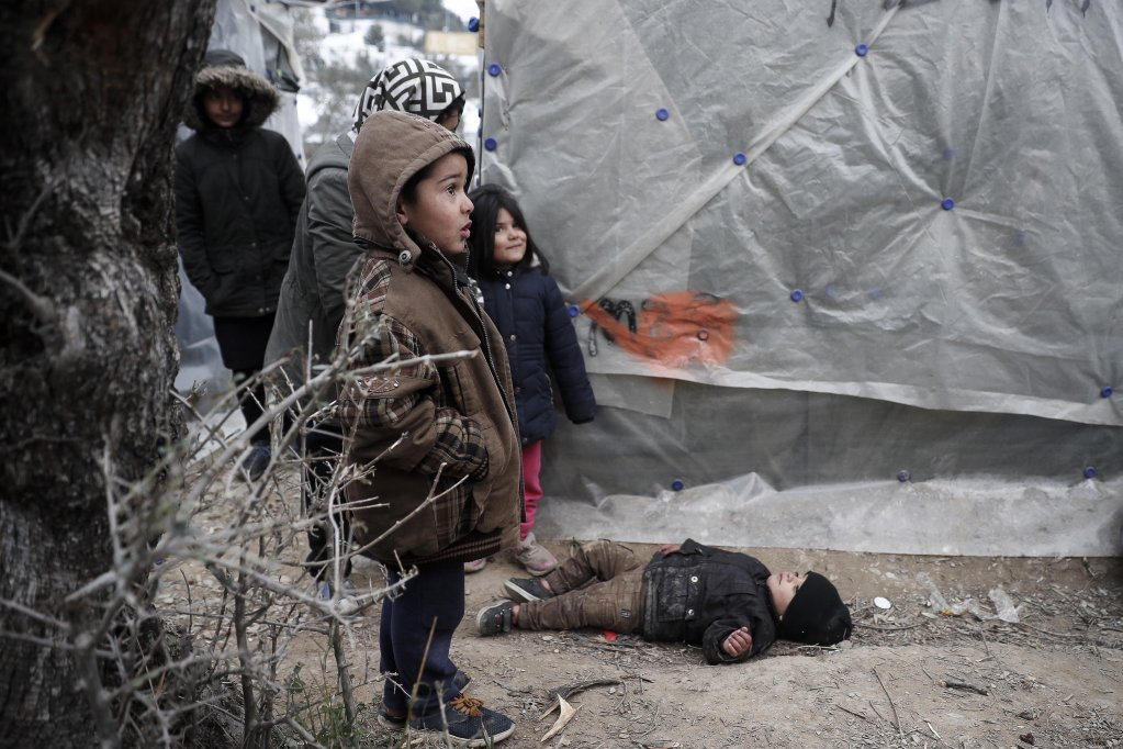 Refugee children outside their tent in an olive grove next to the Moria camp on Lesbos island | Photo: EPA/Dimitris Tosidis
