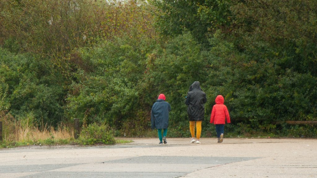 A migrant family walks in the Puythouck forest in Grande-Synthe. Photo: InfoMigrants