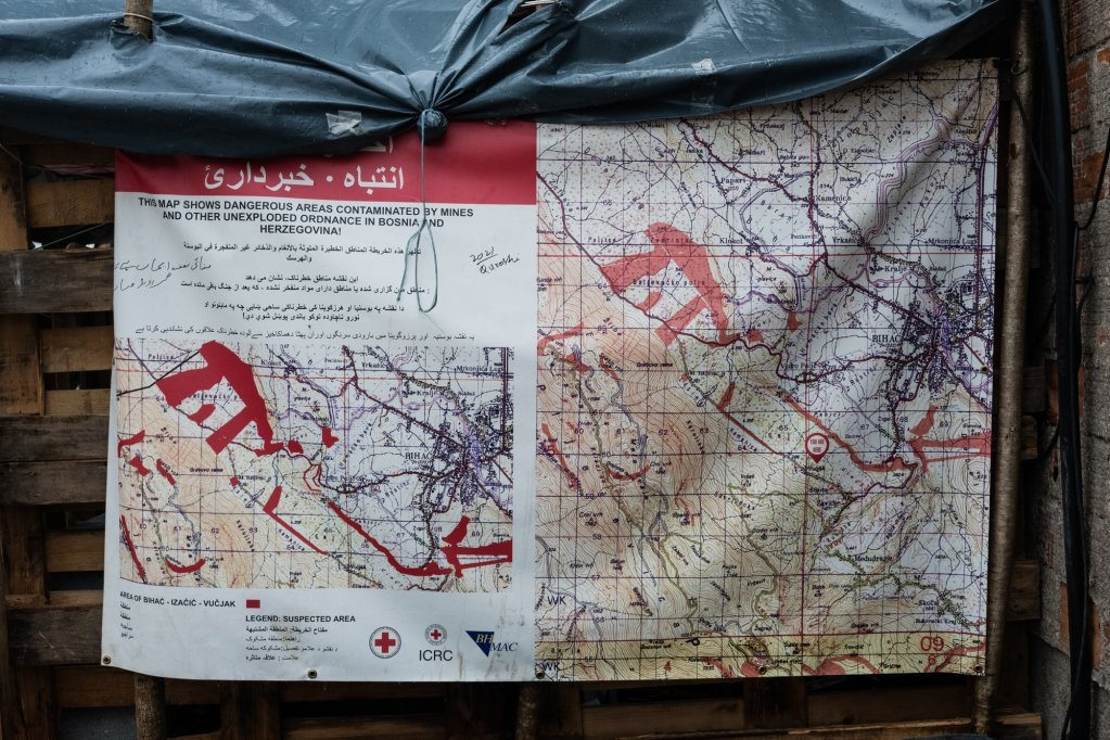 Maps provided by the Red Cross mark land-mined zones a legacy from the 1990s conflict in this area in red Photo credit Jeanne Frank Item