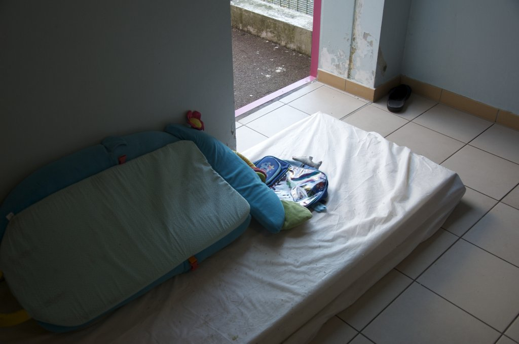 In the familys room a mattress was added to the floor near the door that overlooks the courtyard Credit Mava Poulet  InfoMigrants