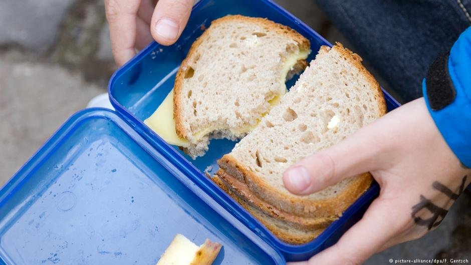 Many migrant children have been forced to eat sandwiches in a separate room, away from their friends