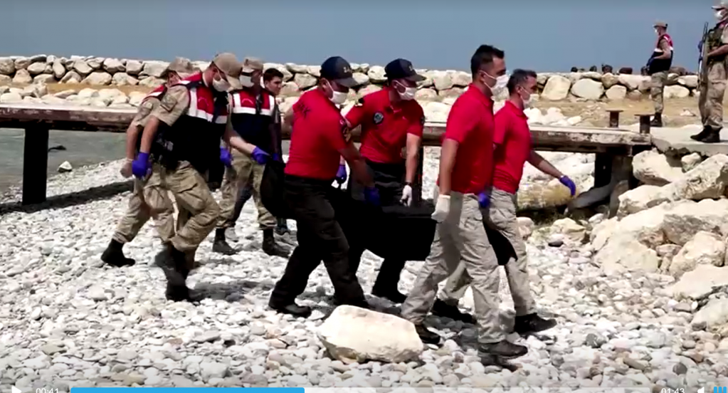 Ambulance workers carry a body bag to shore on lake Van in eastern Turkey | Source: Screenshot Reuters video footage published July 18, 2020