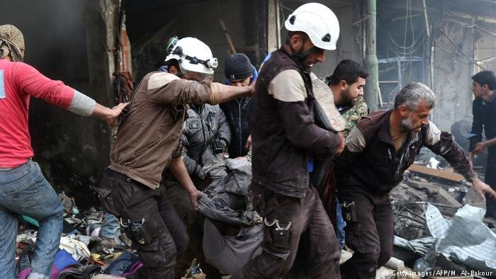 Members of the Syrian Civil Defense engaging in a rescue mission
