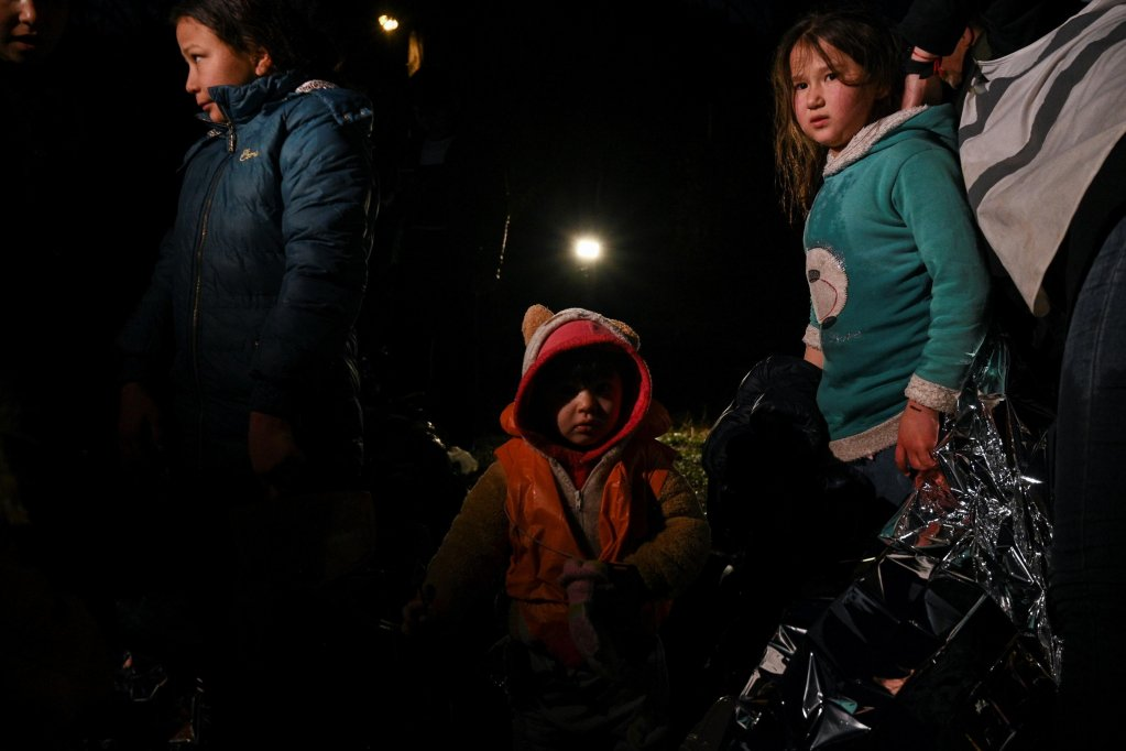 Migrant children are pictured near Skala Sykamineas on the Greek Lesbos island after crossing the Aegean sea between Turkey and Greece on March 1, 2020 | Photo: EPA