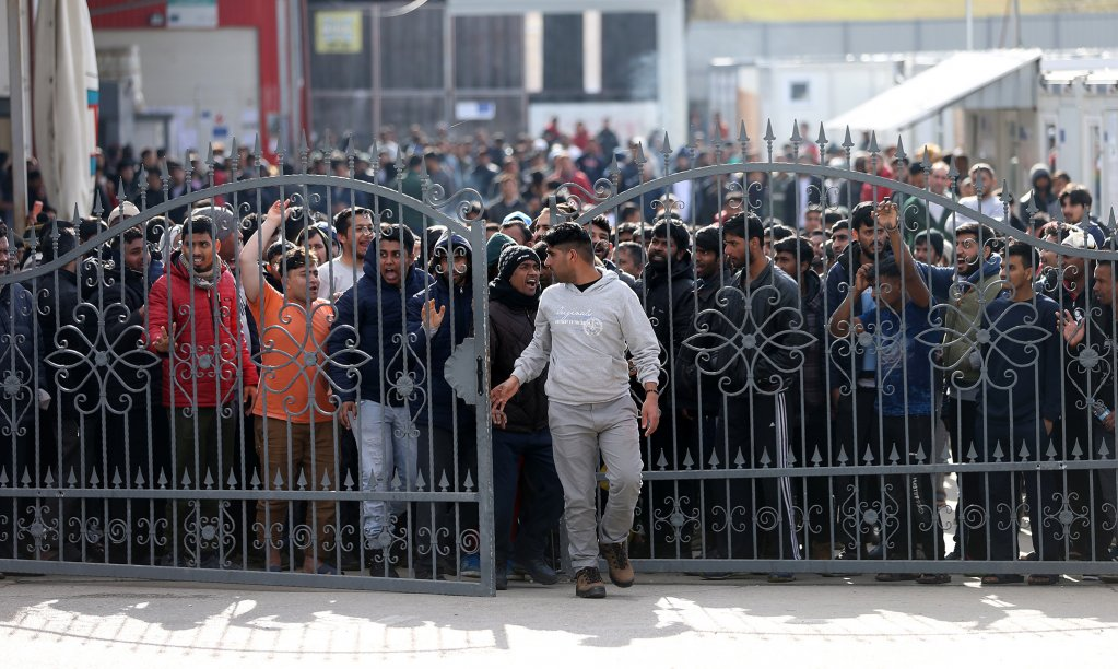 Migrants break through a fence as they protest in front of the refugee camp Miral in Velika Kladusa Bosnia and Herzegovina February 15 2020  Photo ReutersDado Ruvic