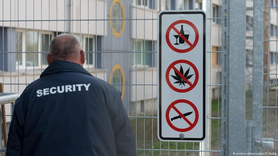 A security guard at a migrant reception center in Saxony