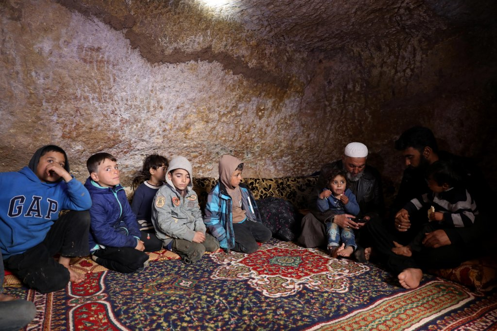 A group of displaced Syrians sit in an underground shelter in the Taltouna village, 17kilometers northwest of the city of Idlib, Syria, | Photo: EPA/Yahya Nemah
