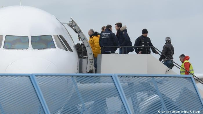 An archive picture showing rejected asylum seekers boarding an aircraft