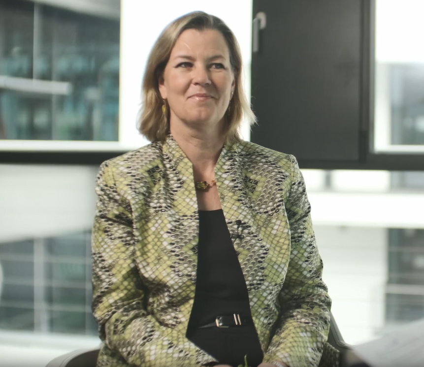 Kelly Clements, Deputy High Commissioner at the UNHCR smiles | Photo: Screenshot from video shot by Cem Springer (InfoMigrants / DW)