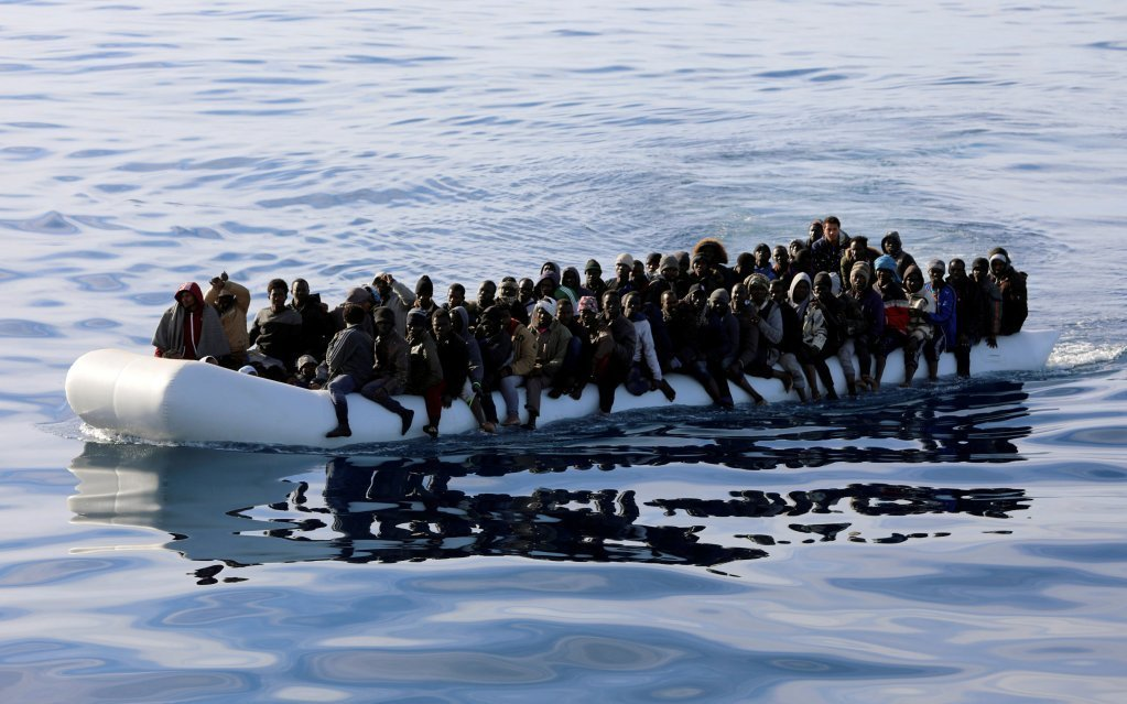 Migrants on board an overcrowded inflatable boat are intercepted by the Libyan coastguard. Photo: Hani Amara, REUTERS file picture