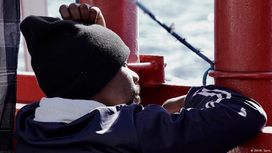 On board the Ocean Viking a migrant looks out to sea  Photo DWM Soric