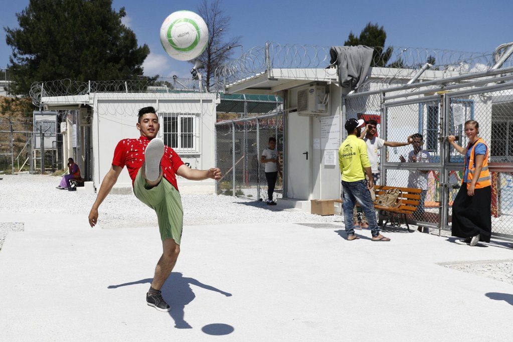 Refugees play football in the Moria refuge camp on the island of Lesbos in Greece  Photo EPAPETER KLAUNZER
