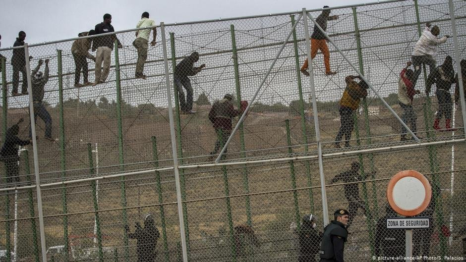 Migrants climbing the fence between Morocco and Melilla  Photo Picture-allianceAP PhotoSPalacios