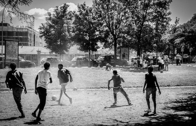 Migrants playing football in Italy's tourist destination Como