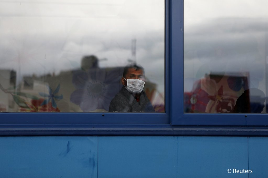 One of a group of migrants who arrived from Turkey waits for an identification process before being transported to the mainland on a Greek navy vessel from the port of Mytilene Lesbos Greece March 5 2020  Photo ReutersE Marcou