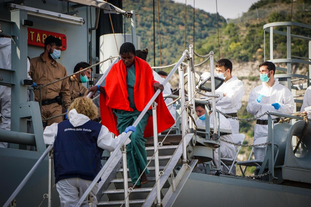 The photo shows migrants landing in Salerno after they were rescued by Spanish vessel 'Cantabria'. The bodies of 23 women were found on the ship. Photo ANSA/Cesare Abbate