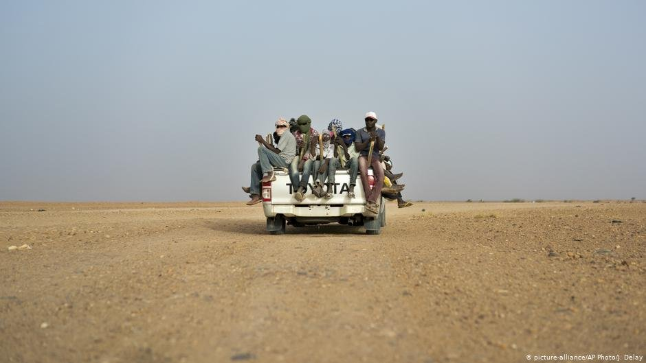 Migrants on a truck in the Saharan desert  Photo Picture-allianceAP PhotoJDelay