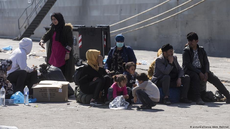 Asylum seekers wait in Lesbos harbor  Photo Picture-allianceAAAMehmet