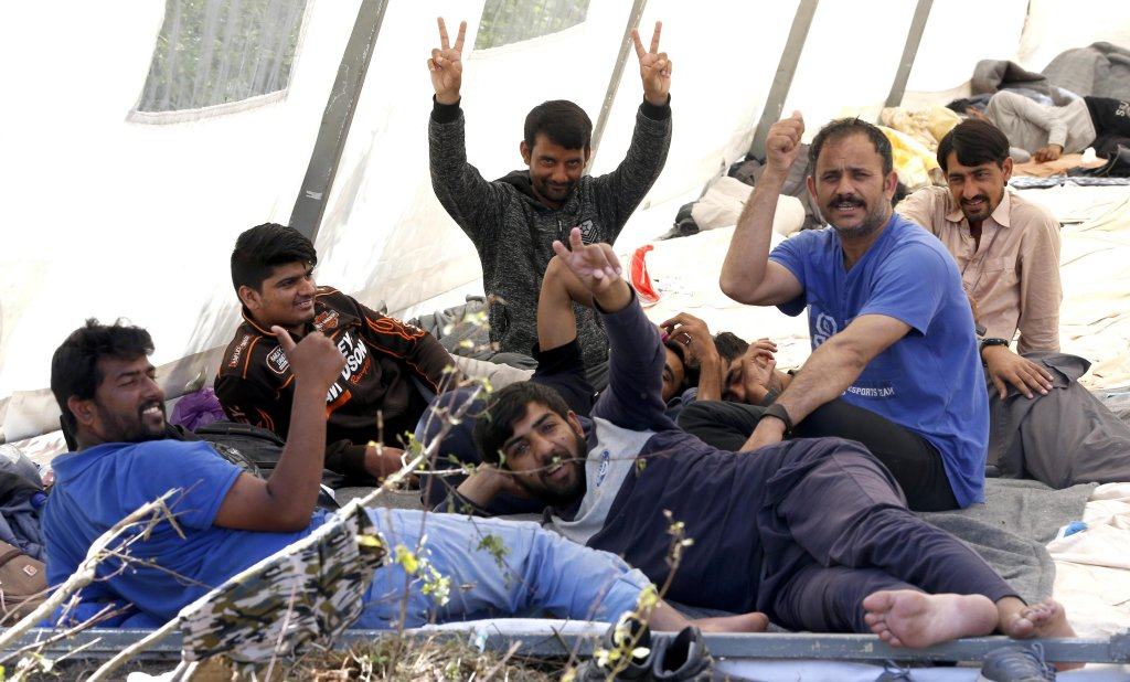 Migrants from Afghanistan and Pakistan sit inside a tent in a camp Bihac Bosnia and Herzegovina  Photo  EPAFehim Demir