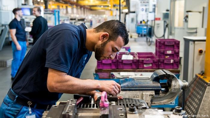 A Syrian refugee working at BMW