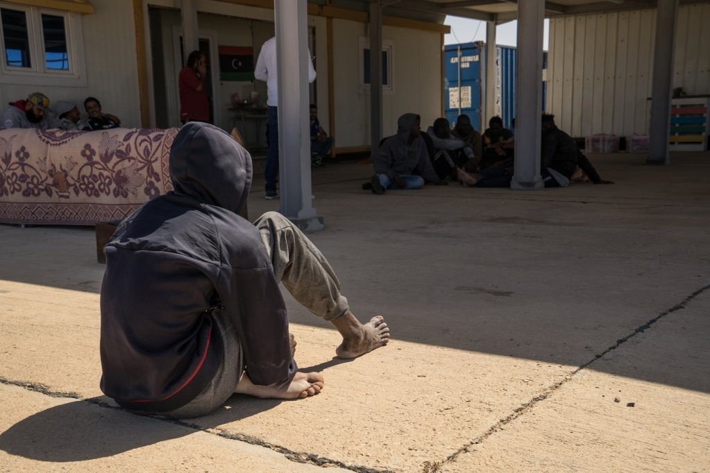A migrant sits at the port after a rescue operation 25 miles north of Zuwara, Libya in early May 2018 | Photo: Zuhair Abusrewil