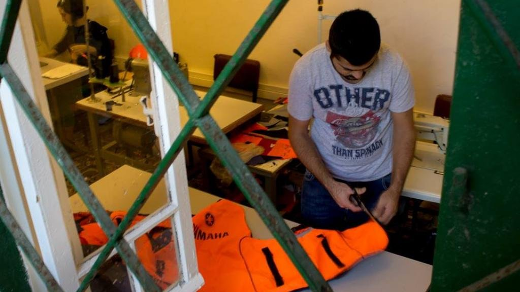 Migrants on Lesbos turn discarded life jackets into accessories