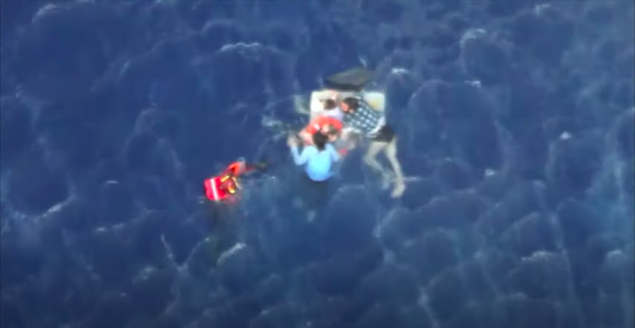 Migrants are helped to safety in a Greek coast guard helicopter rescue on August 26 2020  YouTube screenshotHellenic Coast Guard