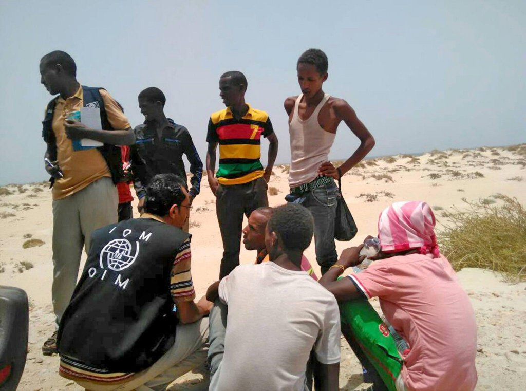 IOM staff assisting Somali and Ethiopian migrants who were reportedly forced into the sea by smugglers on a beach in Shabwa Yemen  Photo EPAIOM