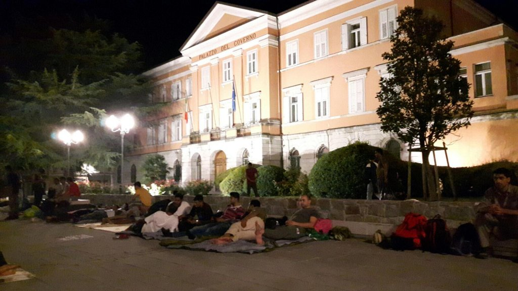 Migrants slept last summer in front of the government delegration in Gorizia to protest against the Mayor who wanted them out of public parks Credit: ANSA/ Stefano Bizzi)