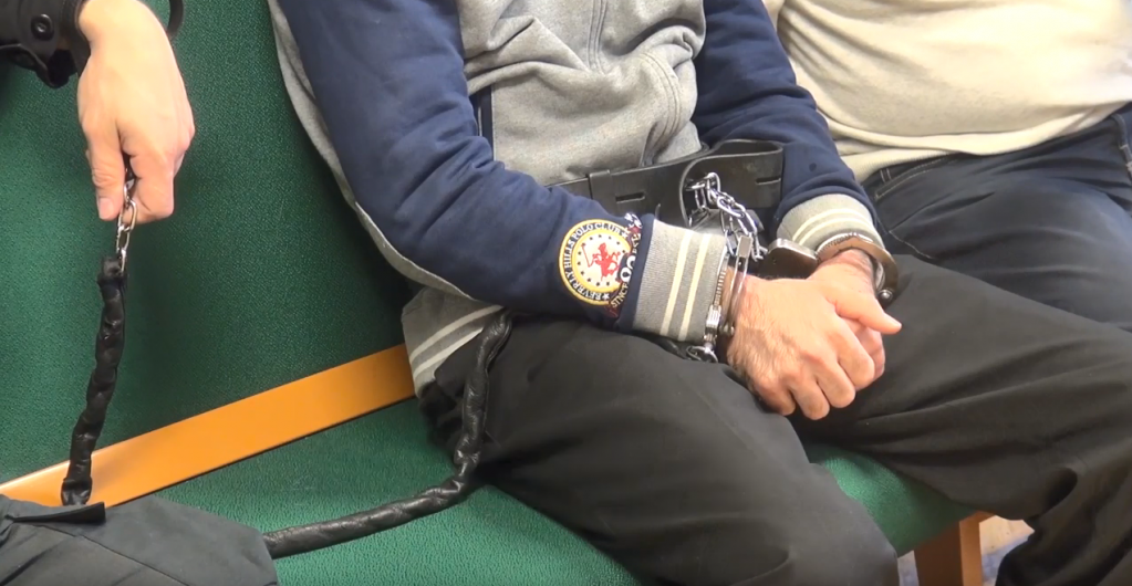 A screenshot of Ahmed with bound hands in court in Hungary | Credit: Screenshot from Amnesty International Deutschland film about Ahmed's case from February 2018