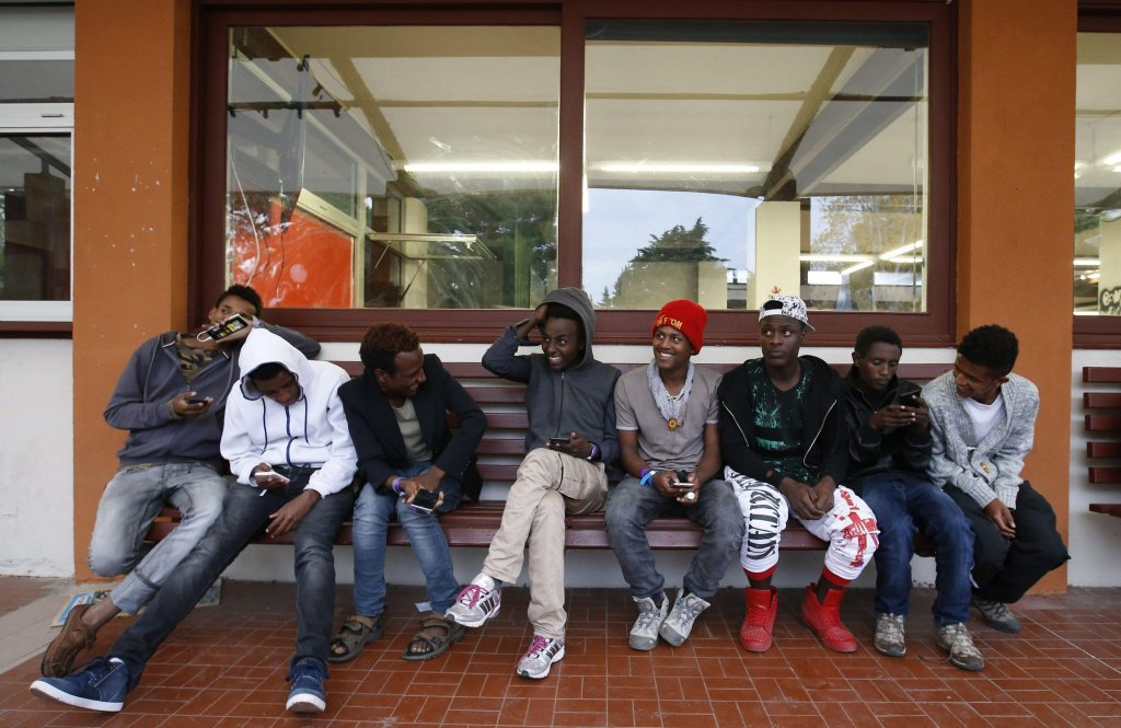 Young migrants hang out at the Community Center for Social Action (CCSA) reception center in Sainte-Marie-La-Mer, a town neighboring Perpignan in southern France PHOTO/Archive/EPA
