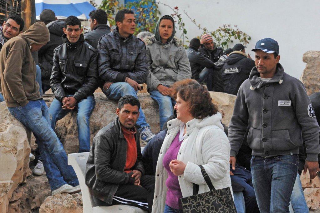 ANSA / مهاجرون تونسيون في لامبيدوزا. المصدر: أنسا/ كيرو فوسكو.