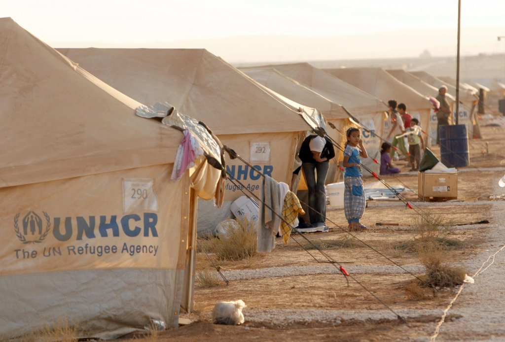 """ansa / بعض الأطفال السوريين في مخيم الزعتري في محافظة المفرق الأردنية. المصدر: صورة أرشيف من """"إي بي إيه""""."""