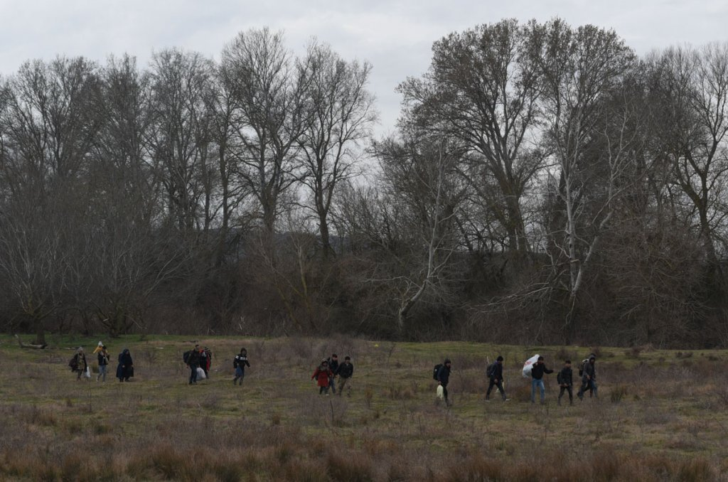 A small group of migrants walking across a field south of Edirne  Photo Mehdi Chebil