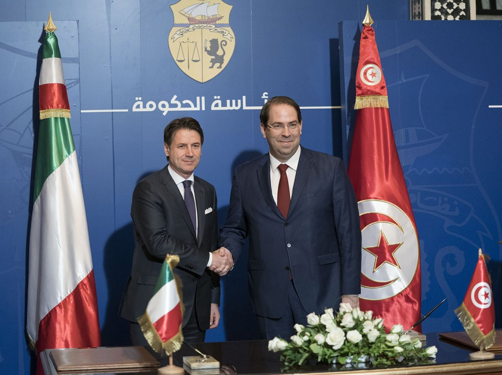 Italian Prime Minister Giuseppe Conte and Tunisian Prime Minister Youssef Chahed shake hands  Credit Use of this photo with kind permission of the Italian Government under the Creative Commons Licence CC-BY-NC-SA 30 IT