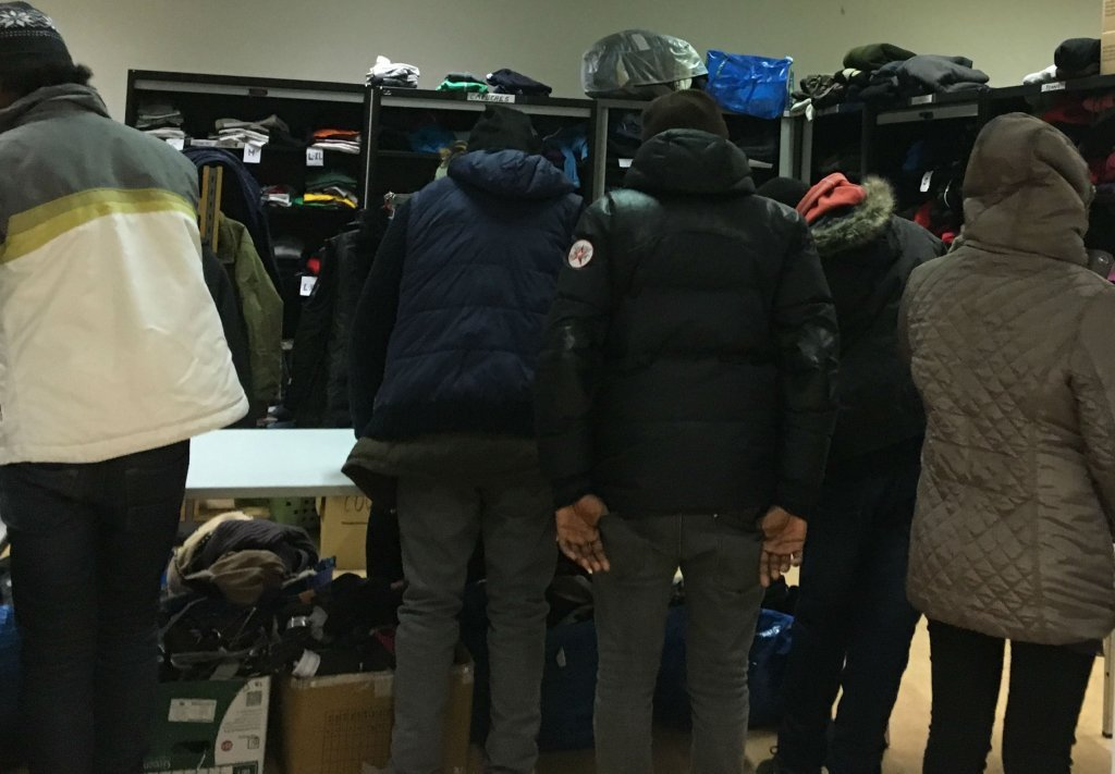 Choosing clothes at a distribution center in Belgium  Photo InfoMigrants