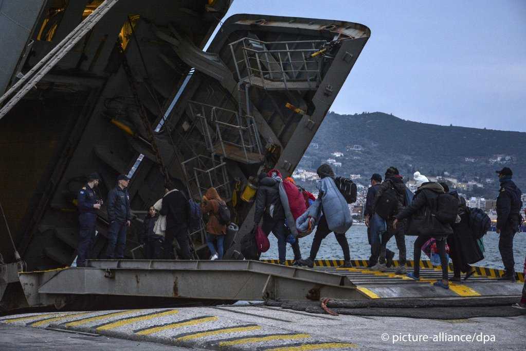 Migrants enter a Greek navy ship which will accommodate them at the port of Mytilene Lesbos Greece on March 4 2020  Photo picture allianceP Balaskas