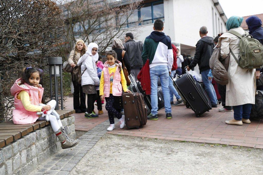 Des réfugiés syriens arrivent dans un camp de réfugiés et migrants à Friedland, en Allemagne, le 4 avril 2016. Crédit : Reuters